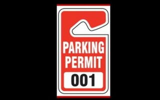Red and white Parking permit tag with the number 001